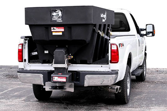 Large Salt Dogg equipment in truck bed of white pickup truck