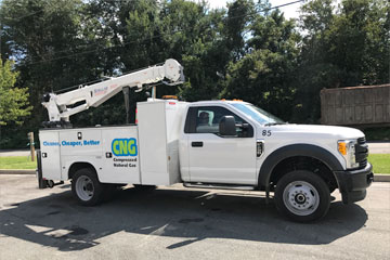 White truck with CNG logo on side