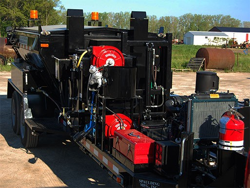 Very large black piece trailer with equipment