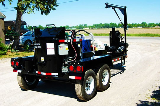 Black trailer with maintenance equipment on it