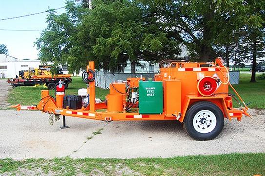 Orange road maintenance equipment on driveway