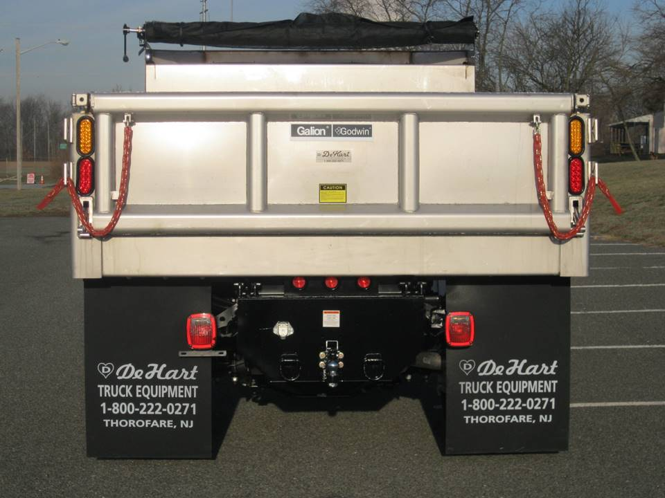 Rear view of tan colored dump truck