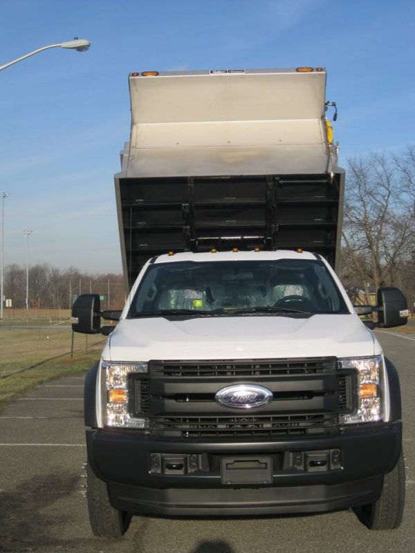 Front of dump truck with truck bed hoisted