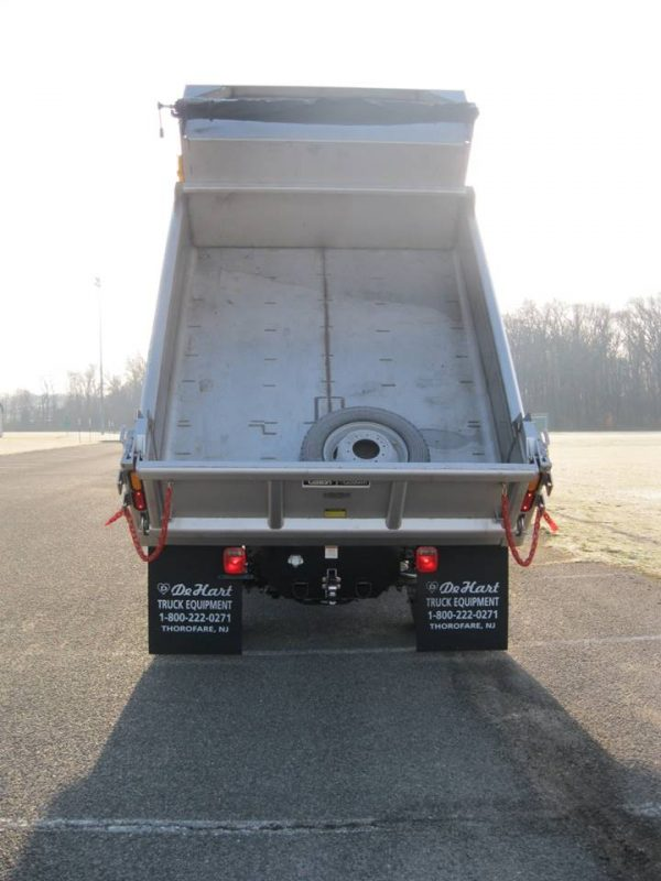 Rear view of dump truck with truck bed fully hoisted