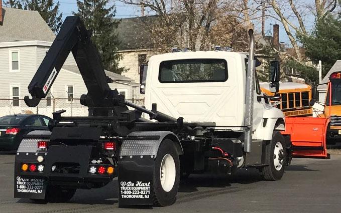 White tow truck on street