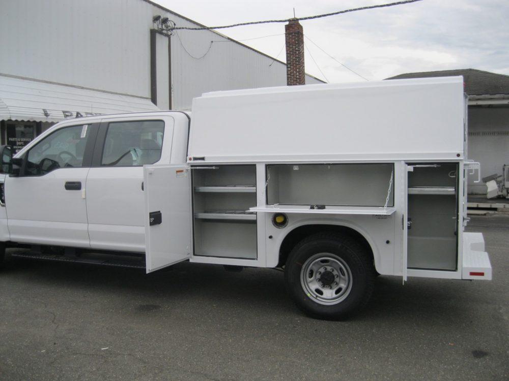 Left side view of white Knapheide Low Roof utility truck