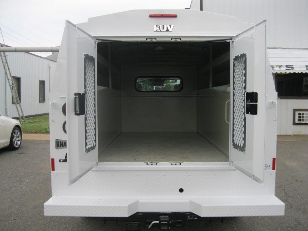 Open trunk of white Knapheide Low Roof utility truck