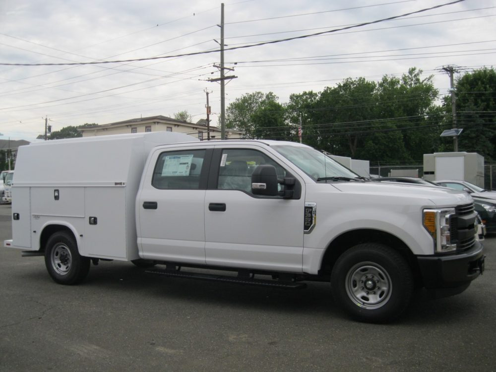Front right view of white Knapheide Low Roof utility truck