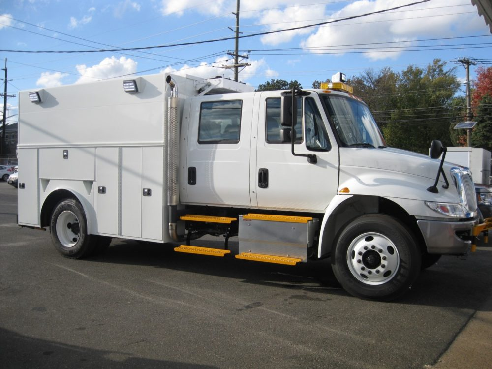 Side right view of white utility truck