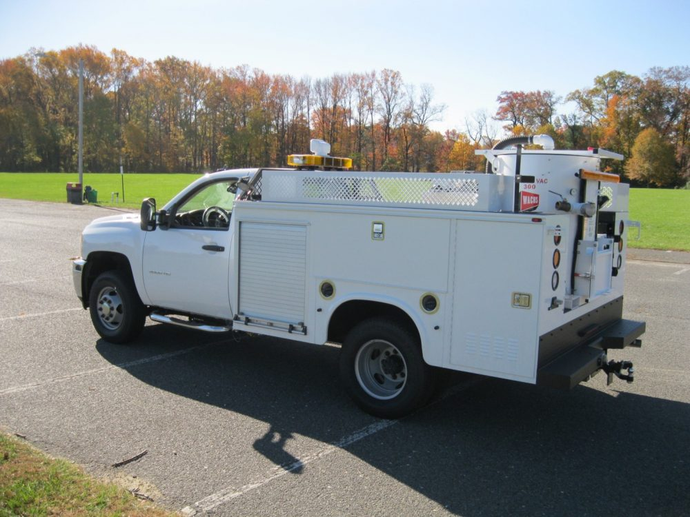 Side view of white utility truck