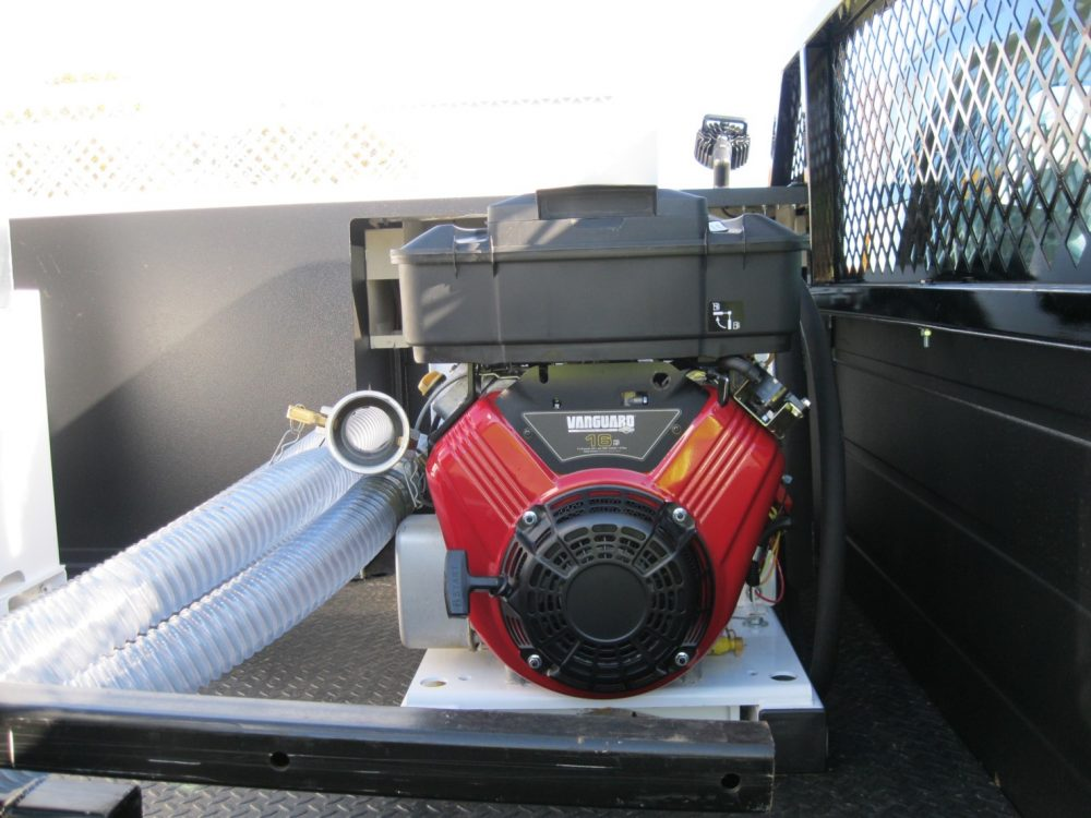 Motorized pump on truck bed