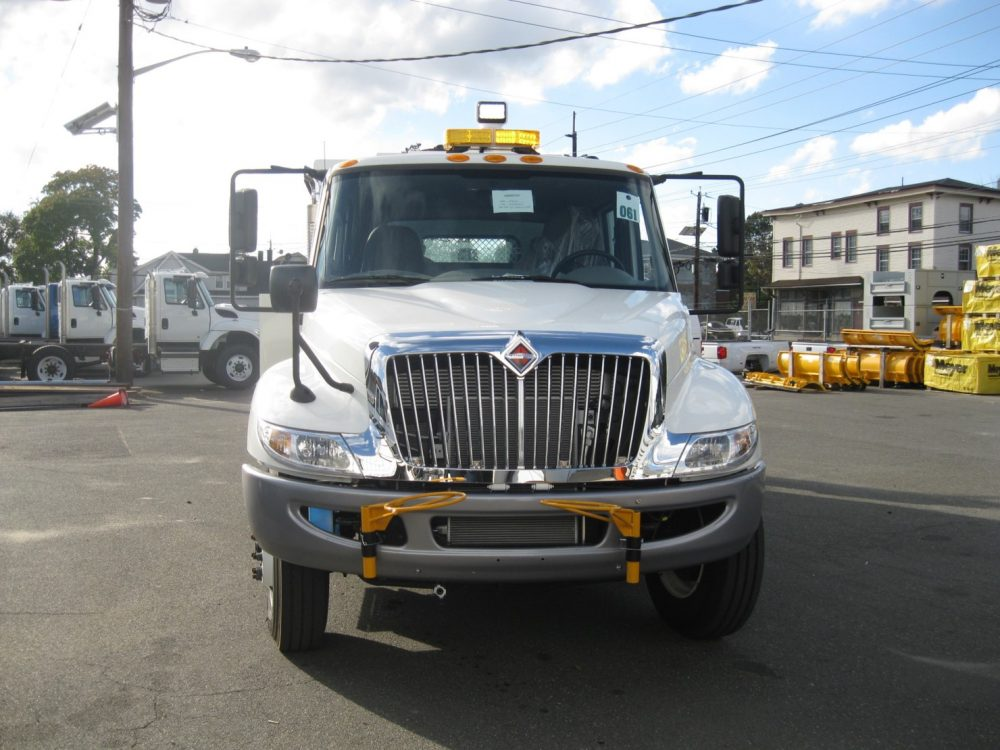 Front view of white utility truck