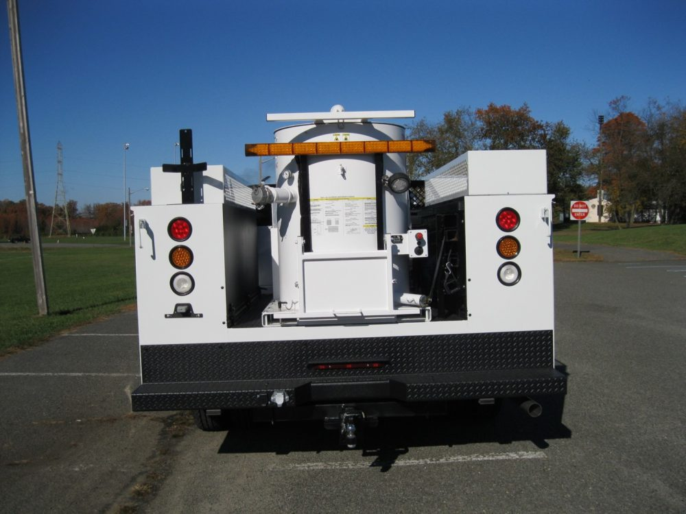 Rear view of white utility truck with equipment