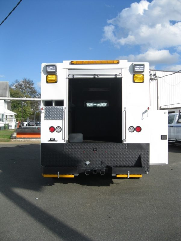 Rear view of utility truck with back open