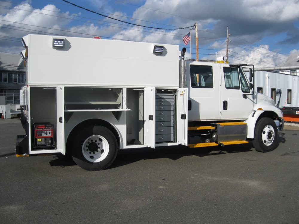 Side view of utility truck with compartments showing