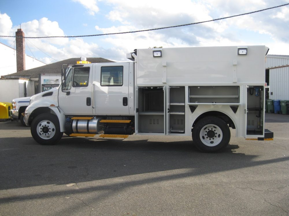 Side view of utility truck showing it's compartments
