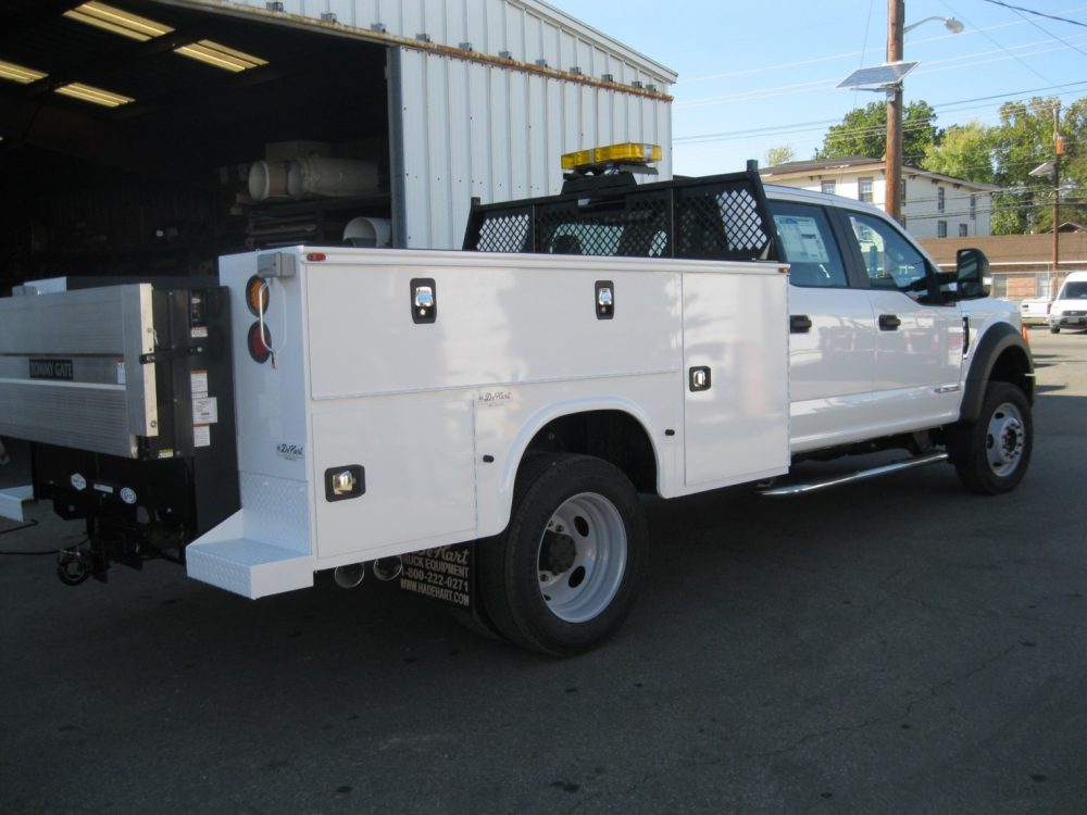 White truck with equipment in daylight