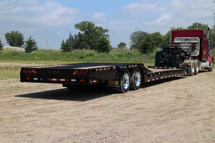 Close up of black Towmaster trailer with loading lift folded up