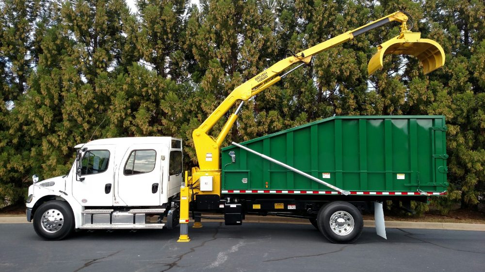 White semi truck with green truckbed