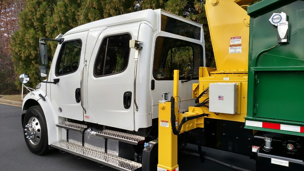 Close up of white semi truck with yellow equipment